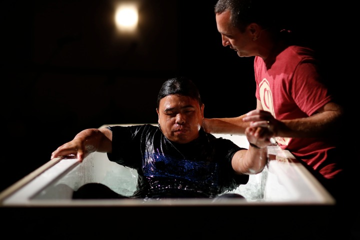 Pastor Ken Sirmans baptizing one of the refugee