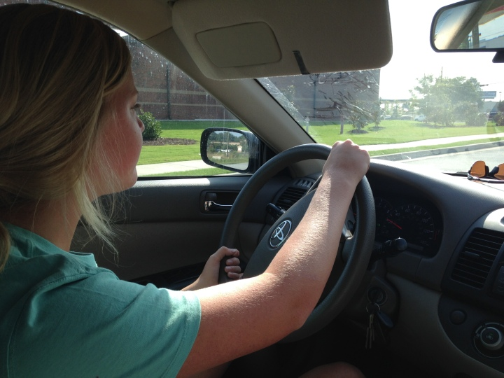 Julia, my 15 year old daughter, driving after just getting her learner's permit.